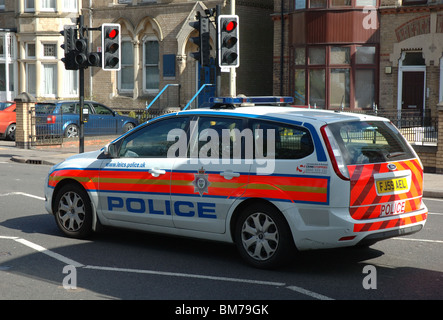 police car waiting at traffic lights, Leicester, Leicestershire, England, UK - Stock Photo