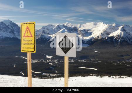 Black diamond and marginal conditions signs at Lake Louise Ske Resort - Banff National Park, Alberta, Canada - Stock Photo