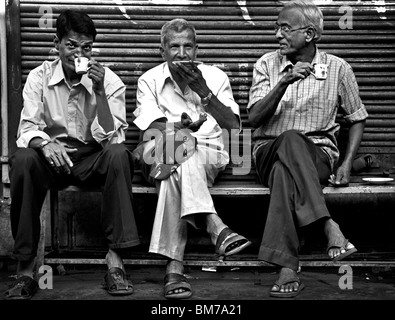 men drink tea in the old town in Ahmedabad, Gujurat India - Stock Photo