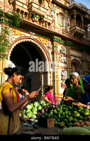 A vegetable merchant in the old town in Ahmedabad, Gujurat India - Stock Photo