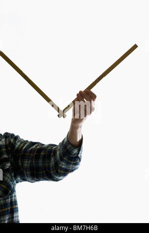 A carpenter using a folding ruler - Stock Photo