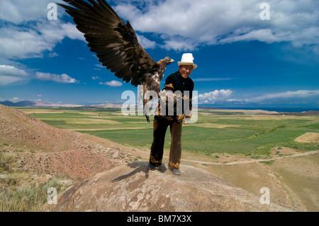 Eagle, raptor hunter, Issy Köl, Kyrgyzstan - Stock Photo