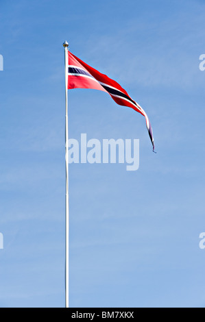 A Norwegian Vimple [Pennant], Narrow Long Flag Flying from Flagpole in Clear Blue Sky in Bergen Norway - Stock Photo