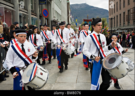 Local Clubs Bands Groups Families Schools March Through Bergen City Centre In Celebration of Norwegian Independence - Stock Photo