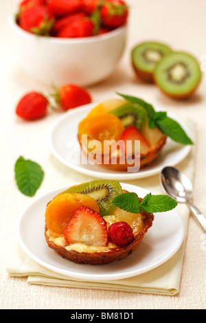 Cream and fruit tartlets. Recipe available. - Stock Photo
