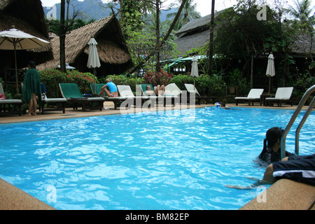 Swimming pool on white sand beach in Koh Chang, Thailand. - Stock Photo