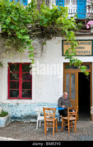 Traditional old cafeneon, cafe, in the Outer Mani village of Kardamyli, Messinia, Peloponnese, Greece. - Stock Photo
