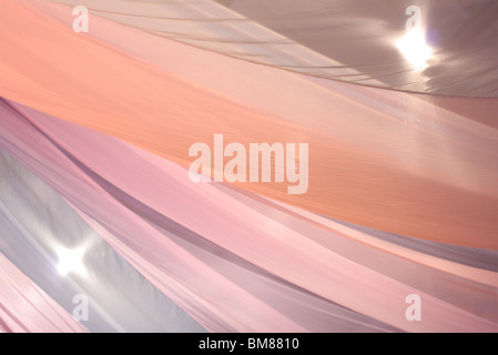 Abstract background blur of tulle in pink tones - Stock Photo