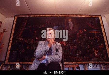 Russian Artist, Ilya Glazunov, sitting in front of his original Controversial painting 'Mystery of the Twentieth - Stock Photo