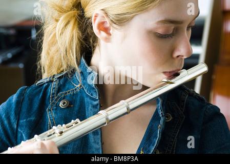 Flautist practicing - Stock Photo