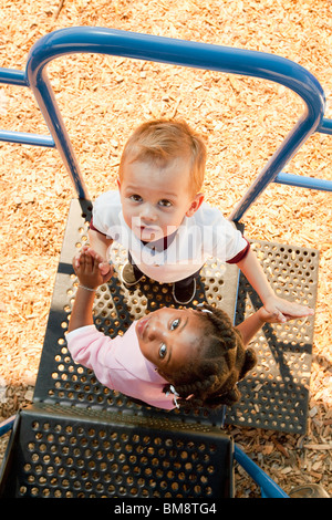 Fort Lauderdale, Florida, United States Of America; Two Young Children Playing At A Playground - Stock Photo