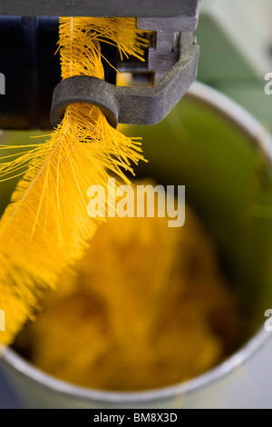 Fabric coating plant, weaving department, textile composite fabric selvage - Stock Photo
