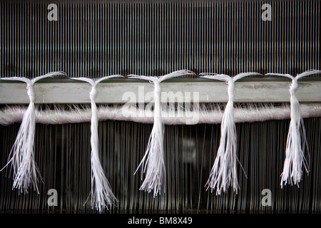 Loom in weaving mill, close-up of weaving reed - Stock Photo