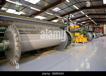 Fabric coating plant, weaving department, weaver's beam and loom - Stock Photo