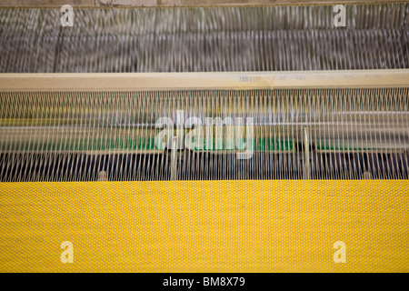 Fabric coating plant, recyclable composite textile weaving department, textile composite fabric on loom - Stock Photo