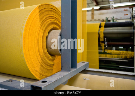 Fabric coating plant, recyclable composite textile weaving department, roll of textile composite fabric - Stock Photo