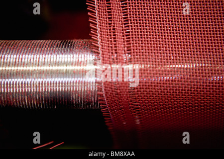 Fabric coating plant, recyclable composite textile weaving department, loom - Stock Photo