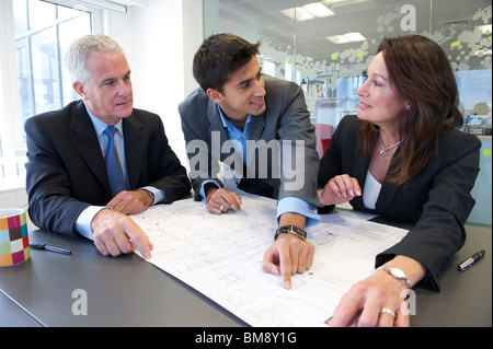 Business meeting with plans - Stock Photo