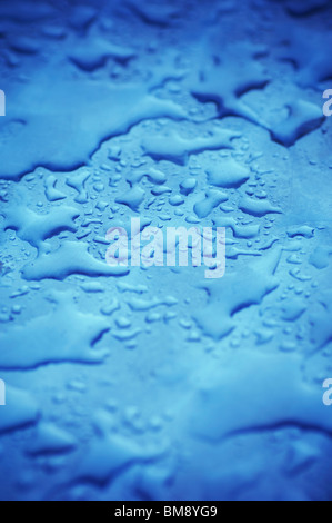 Water on blue metal surface - Stock Photo