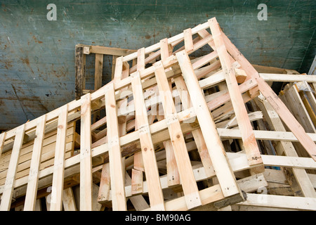 Used wood pallets in dumpster for recycling at industrial plant - Stock Photo