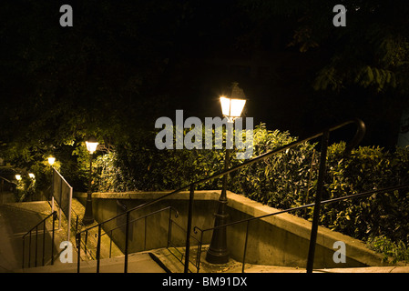 France, Paris, Montmartre, stairs lit by street lamps at night - Stock Photo