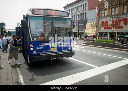 Commuters board a NJ Transit 'GoBus' on Broad Street in downtown Newark, NJ on Saturday, May 22, 2010. (© Richard - Stock Photo