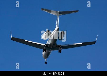 Gulfstream Aerospace G-IV with landing gear down. - Stock Photo