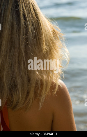 Rear view closeup of a woman by the Mediterranean sea Beirut Lebanon Middle East - Stock Photo