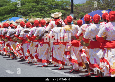 Participants dancing in Harvest Festival Parade with colorful costume, Curacao, Netherlands Antilles. - Stock Photo