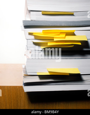 Stack of books with post-it or sticky notes - Stock Photo