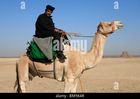 Mounted Egyptian police officer in front of the Black Pyramid of Egyptian Pharaoh Amenemhat III (12th dynasty) at - Stock Photo