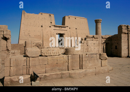 Main entrance of the first pylon of the Temple of Horus in Edfu, Egypt - Stock Photo