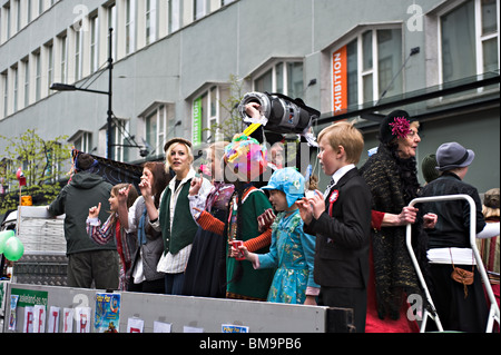 Norwegians Young and Old Sing Along to Music on a Float in The Independence Day Parade in Bergen Norway - Stock Photo