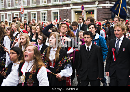 Youngsters Marching in the Traditional 17 May Independence Day Parade in National Costume in Bergen Norway - Stock Photo