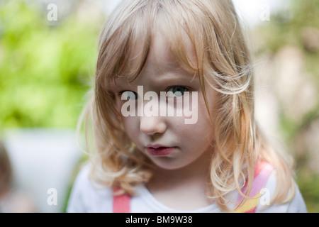 girl 4 years old sad cross sulky portrait - Stock Photo