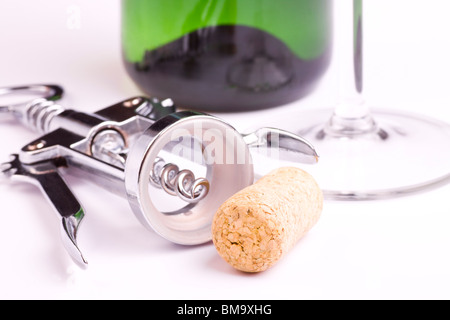 corkscrew and cork closeup with bottle and glass on isolated on white - Stock Photo