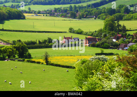 A scenic view on a sunny spring day, from the edge of Hanger Wood with Fingest nestled in the Hambleden Valley. - Stock Photo