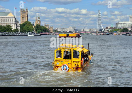 London UK business Duck Tours amphibious transport yellow sightseeing tour boat for tourist travel on River Thames - Stock Photo