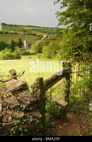 Cotswolds - View over towards St Andrew's parish chuch and the village of Naunton - Stock Photo
