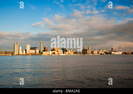 View of Liverpool's famous waterfront across the River Mersey - Stock Photo