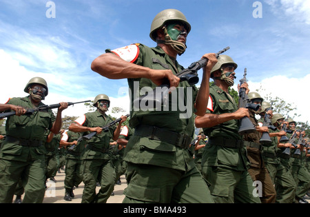 Army reservists march in a military parade in Valencia, Venezuela, June 24, 2006. Photo/Chico Sanchez - Stock Photo