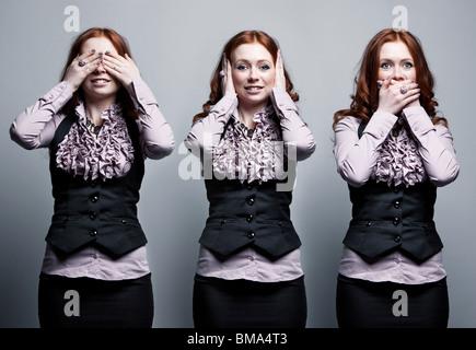See, hear, speak no evil businesswoman concept. - Stock Photo