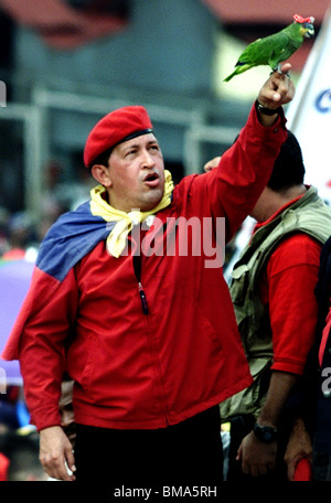 Venezuela's President Hugo Chavez holds up a parrot wearing his iconic red beret at a political rally in Caracas, Venezuela