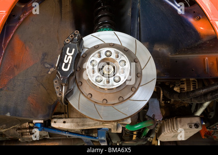 High performance brake disc and calliper / caliper on a race car - Stock Photo