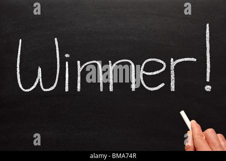 Winner, written on a blackboard. - Stock Photo