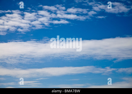 Simple stratified clouds in a blue sky - Stock Photo