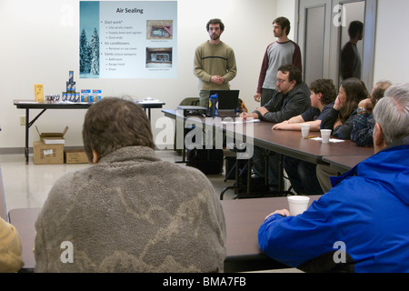 community organizers make a presentation to local residents about saving energy in their homes - Stock Photo