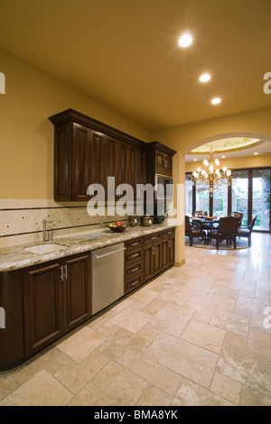Spacious open plan kitchen interior with a long bar for Wooden fitted kitchen