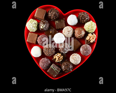 Chocolates in heart shape - Stock Photo