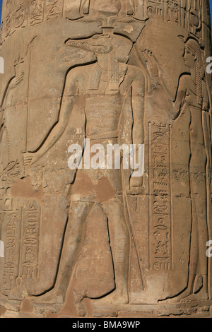 A carving of the crocodile god Sobek wearing the atef crown on a pillar at the Temple of Kom Ombo (180-47 BC) in - Stock Photo